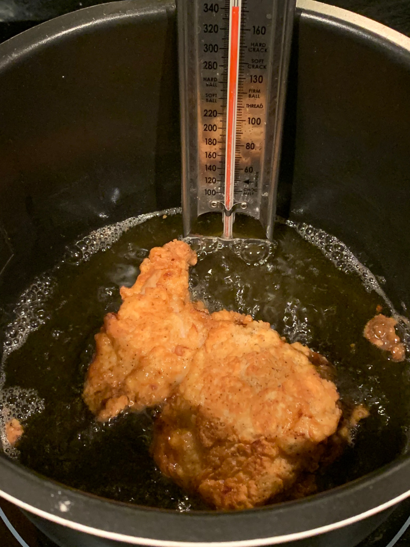 frying chicken in a pan