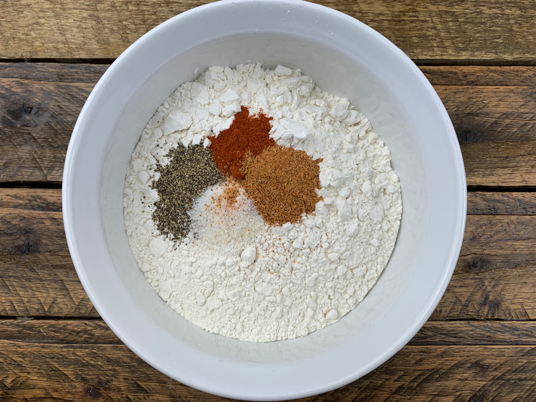 spices and flour in a mixing bowl