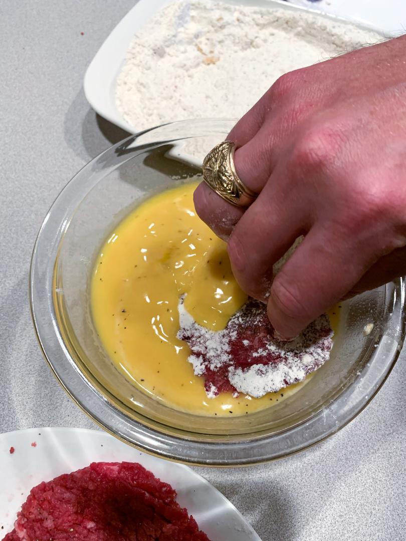 cube steak in egg mixture